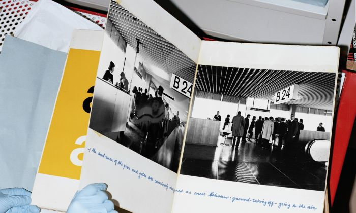 Kho Liang Ie, Schipholboek: a presentation book bound in wood featuring photographs, design studies and handwritten comments about the interior of Schiphol Airport, originally made for a Unesco presentation. Archive Nel Verschuuren/Kho Liang Ie & Associates. Collection Het Nieuwe Instituut, NVER 410. Art direction: Studio Veronica Ditting. Photography: Tim Elkaïm.