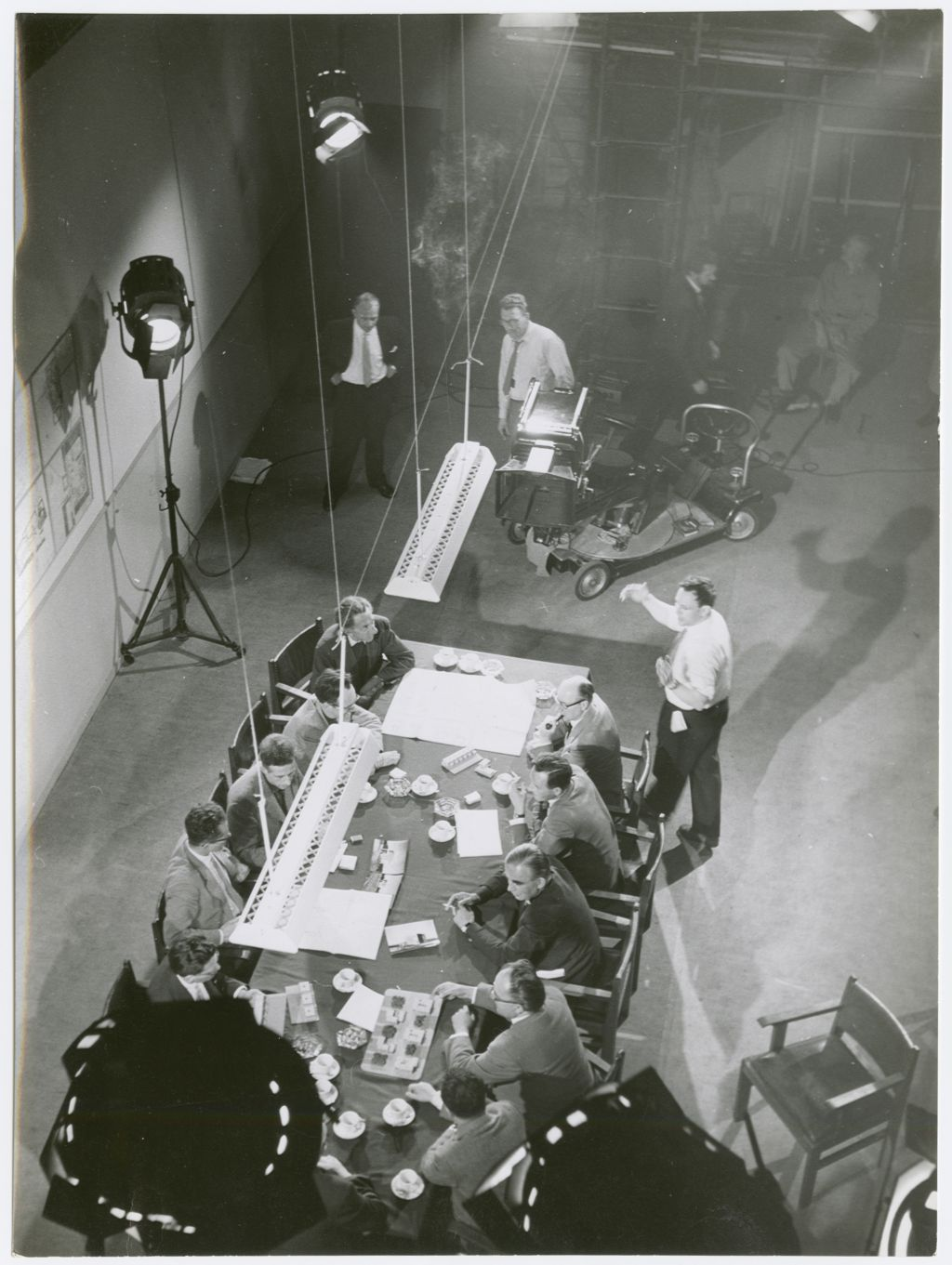 Architects discussing the design of Nagele, while acting in the film 'Een nieuw dorp op nieuw land' (A New Village on New Land) by Louis van Gasteren, 1960. Photo Spectrum Film, Amsterdam. Collection Het Nieuwe Instituut, BODE ph21
